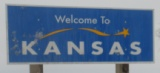 50-states-facts-KS; kansas welcome sign