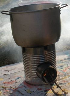 campfire-food-04; homemade rocket stove boiling water