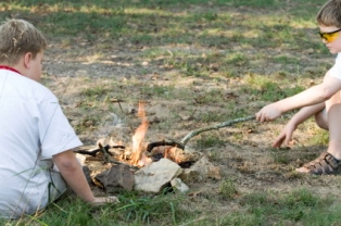 campfire-safety-for-kids-01; two boys engaged in campfire activities