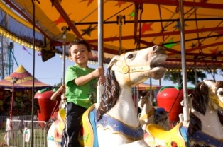 idaho-tourist-information-02; kid on carousel