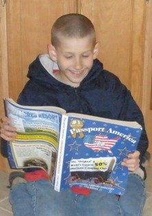 passport-america-camping-01; boy reading passport america camping directory