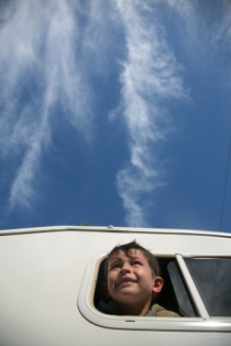 rv-campground-reviews-04; child looking out the window of an rv