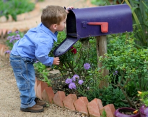 rv-life-styles-06; boy looking into mailbox