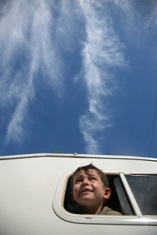 tourist-attractions-in-hawaii-01; boy looking out window