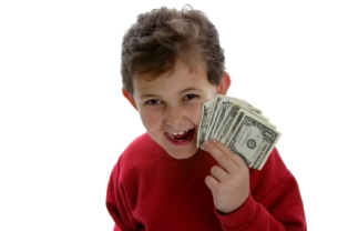 travel-and-make-money-08; boy holding up fistfull of money
