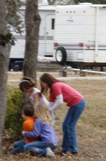 ultimate-family-vacation-adventure-12; three rv girls chasing rv boy at campground playground