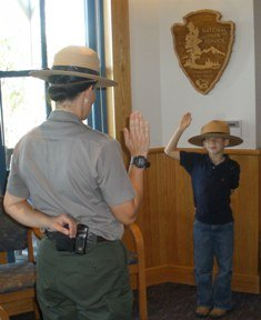 attractions-for-road-trip-03; boy taking junior ranger oath at biscayne national park