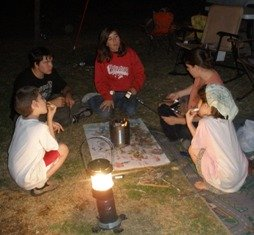 campfire-food-05; group of kids roasting marshmallows over fire