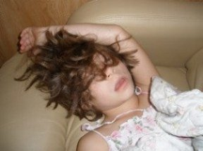 funny-kids-pictures-01; girl asleep on RV sofa