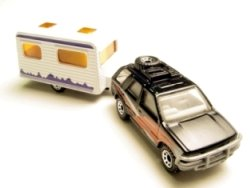 rv-travel-with-kids-01; toy rv suv pulling travel trailer
