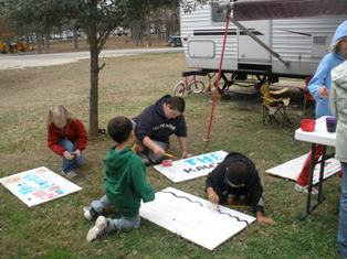 ultimate-family-vacation-adventure-09; fulltime rv kids painting wooden name signs
