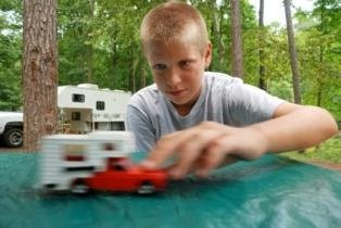 unit-studies-for-homeschooling-02; boy with toy rv