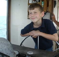 William driving the boat