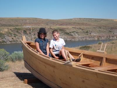 William and Sara in duggout canoe over looking the Missouri River, Great Falls, Montana
