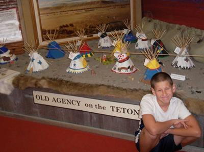 William (age 11) in front of museum model
